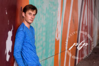 Lakeland Senior Photographer Boy graffiti color Wall.jpg